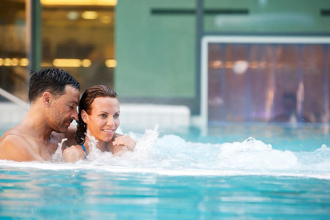 a couple in the thermal water