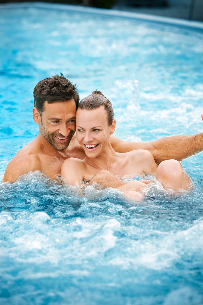A couple enjoys the sparkling thermal water